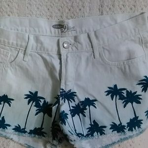 White shorts with teal Palm trees